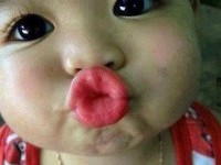 baby kissing photo