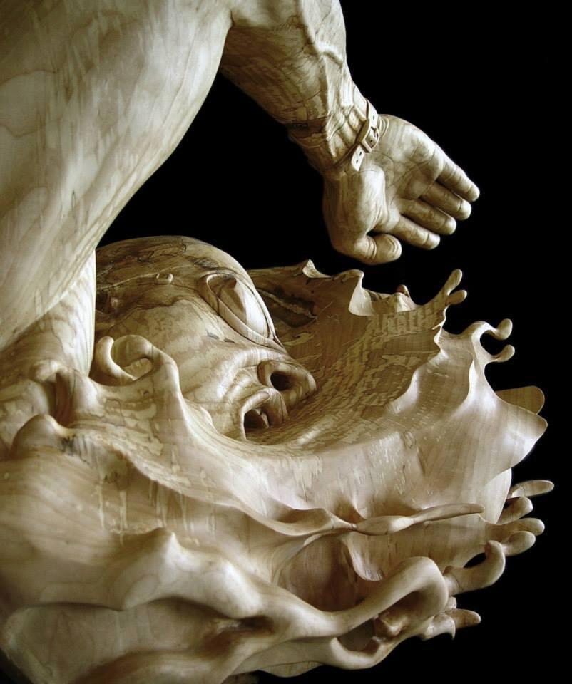 Swimming wood sculpture by Stefanie Rocknak