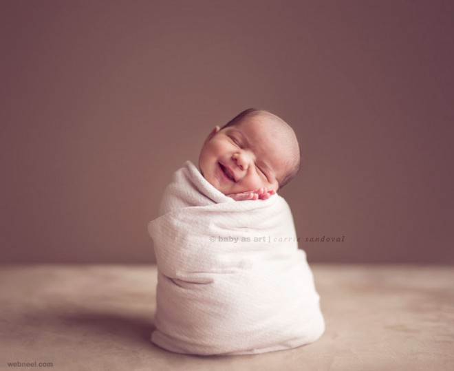 how to make a newborn smile for a picture