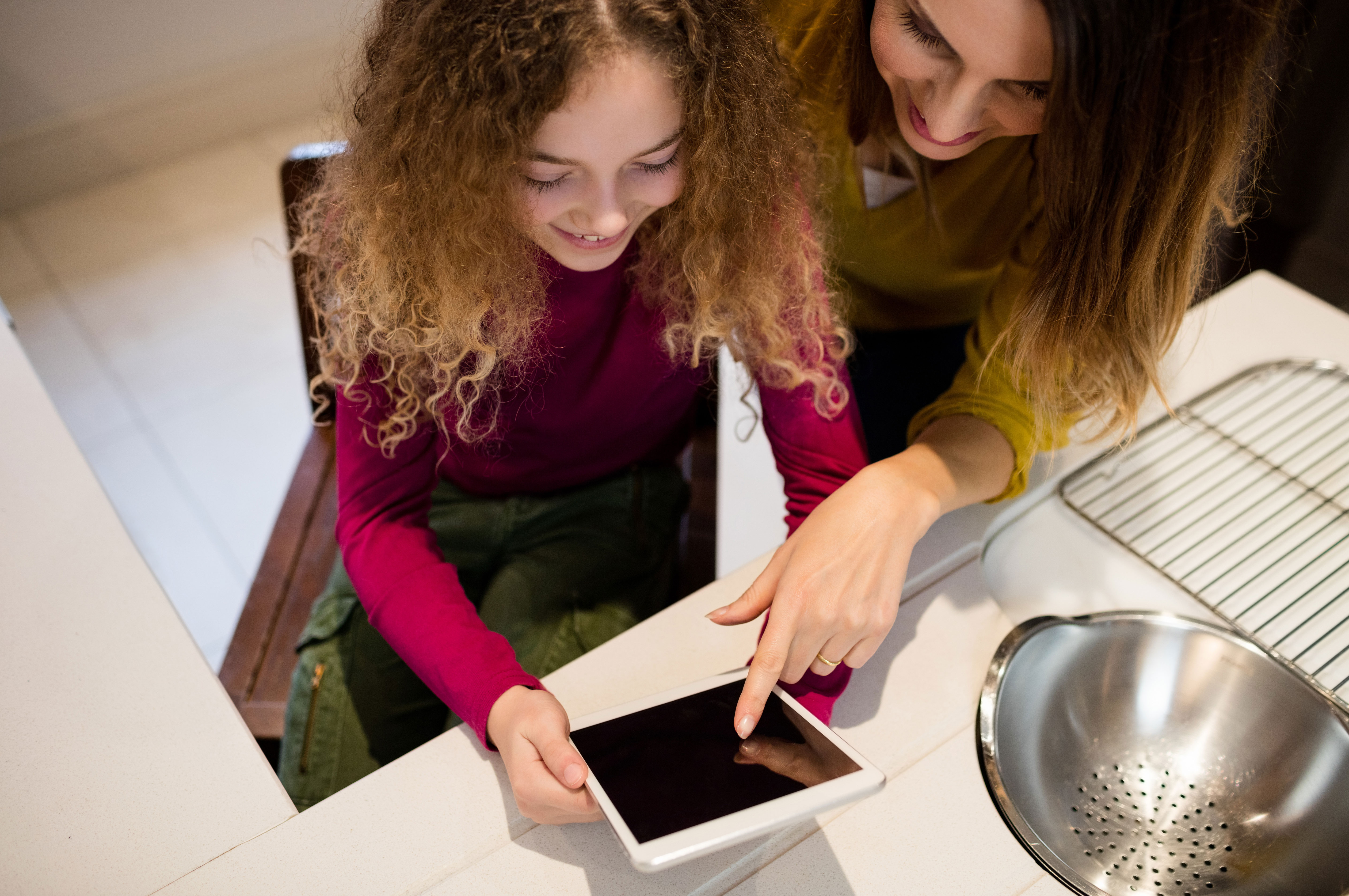 free image mother and daughter using digital tablet by pikwizard