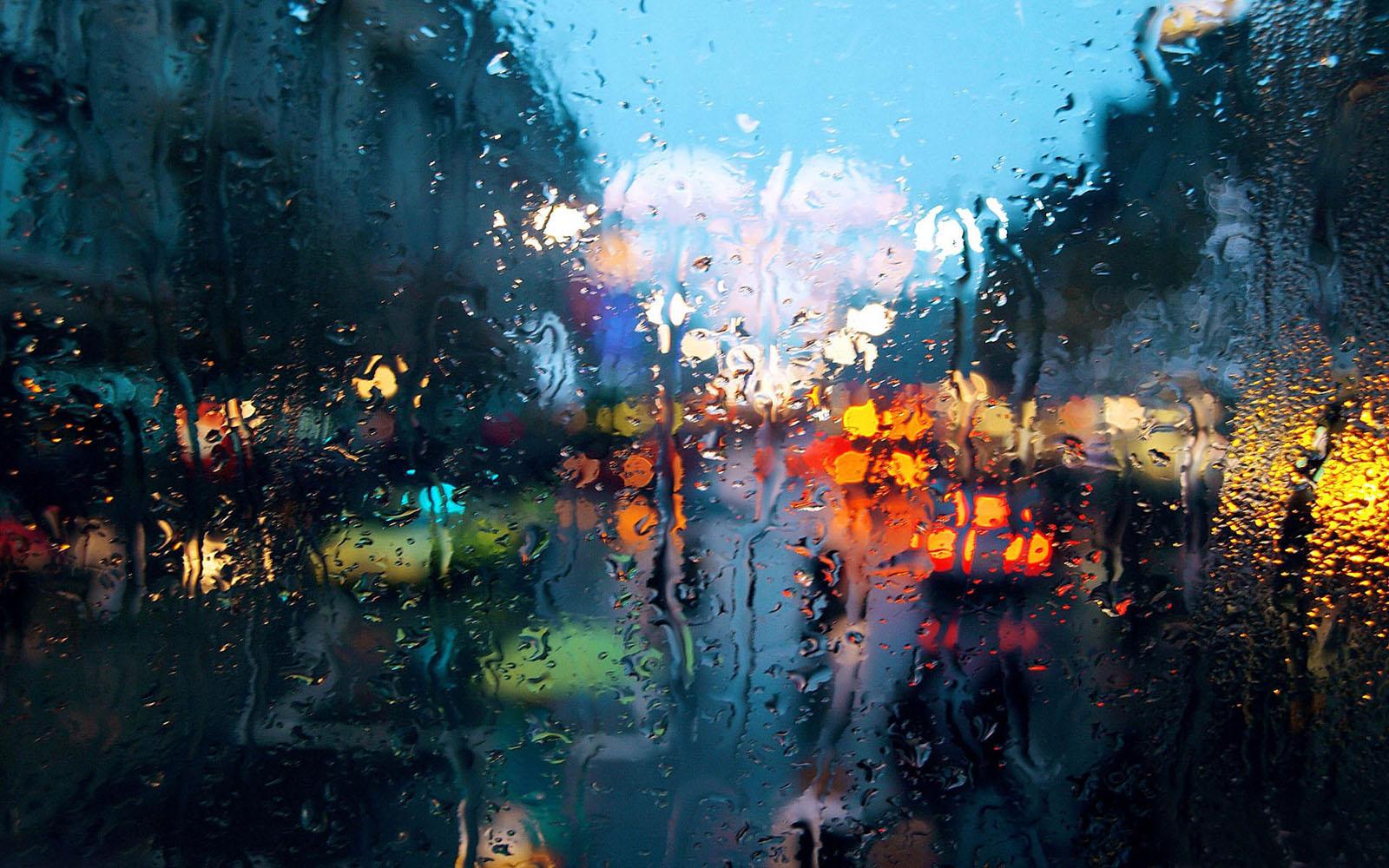 Colourful Rainy Drops On Window Wallpaper  Responsive