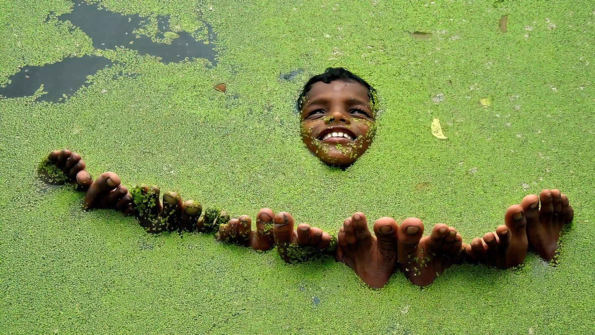 award winning cotient world photography a boy floting in water by nimai chandra ghosh