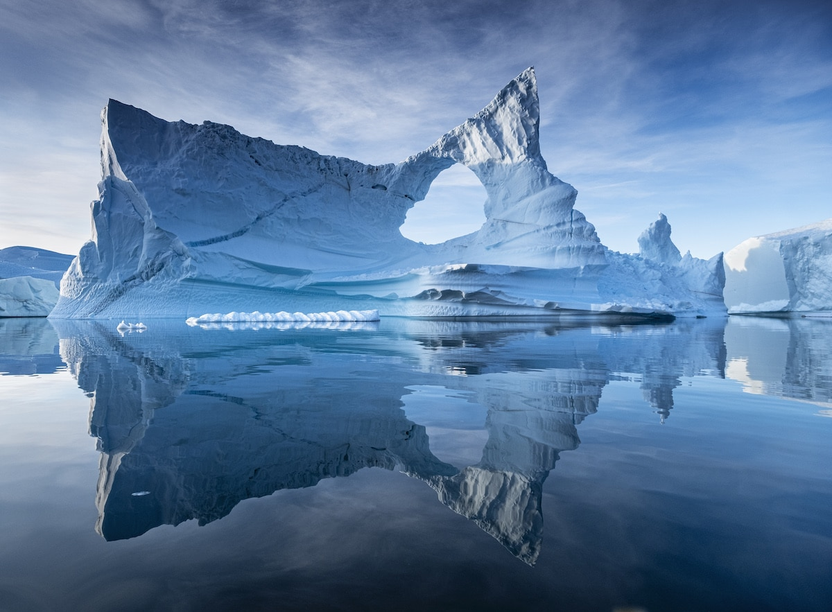 award winning reflection photography ice berg by christopher
