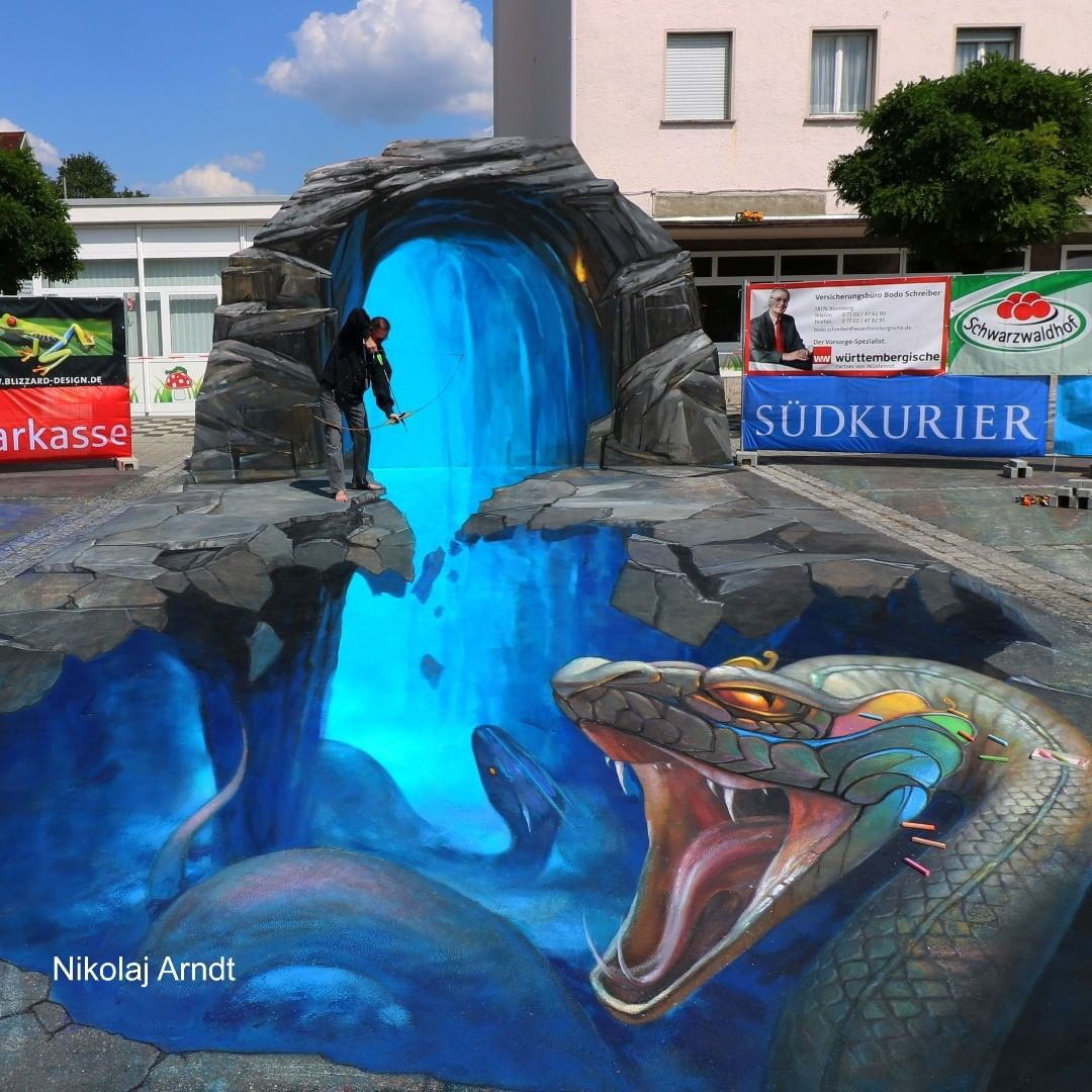 3d street art snakes by nikolaj arndt