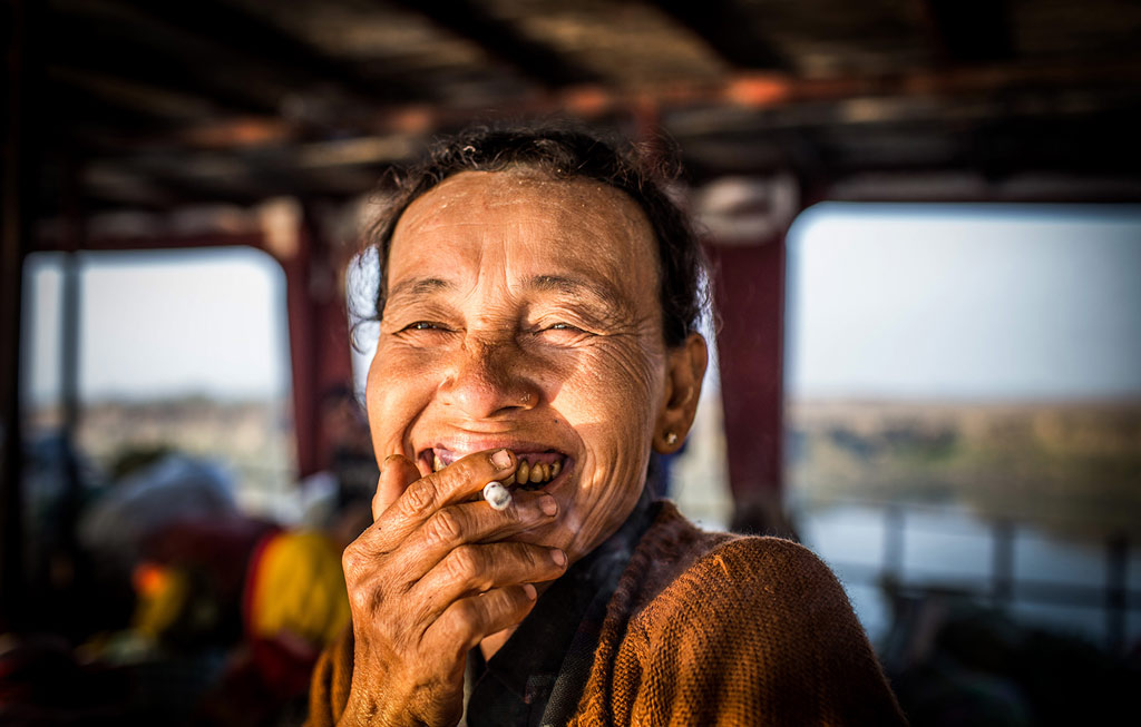 woman on the ferry myanmar by paul ratje