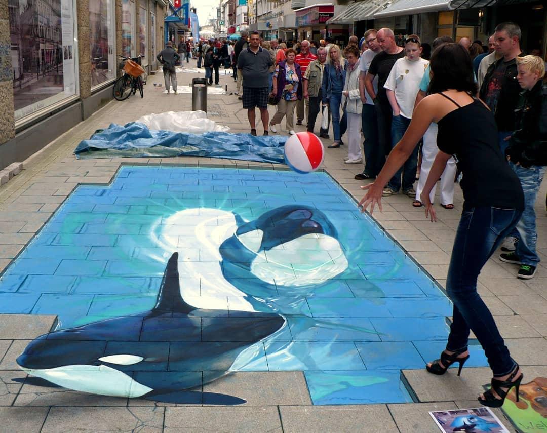 3d street art dolphin play by nikolaj arndt