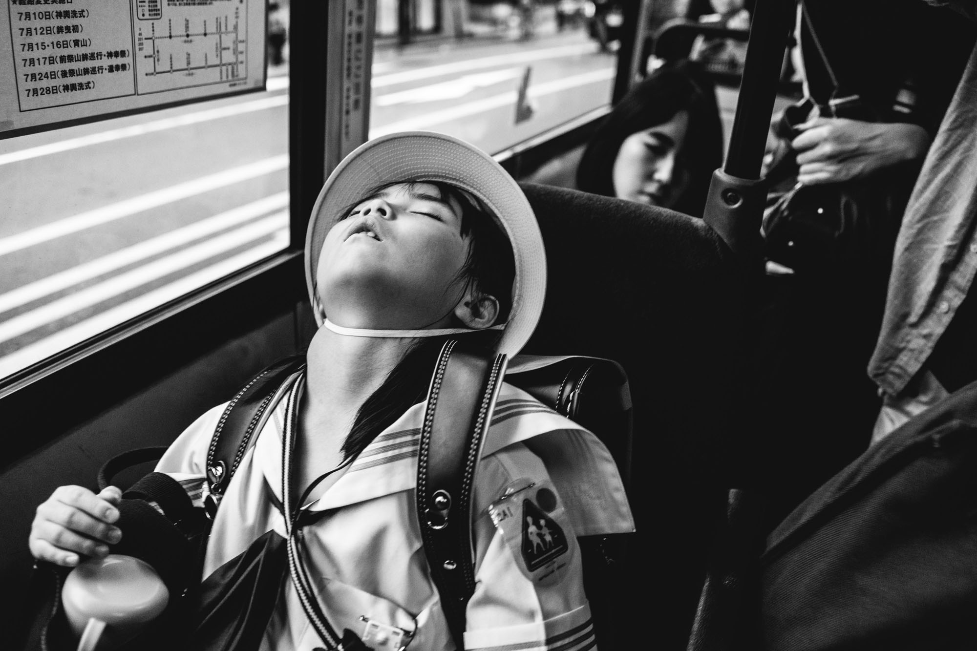 sleep passenger street photography by jian seng so