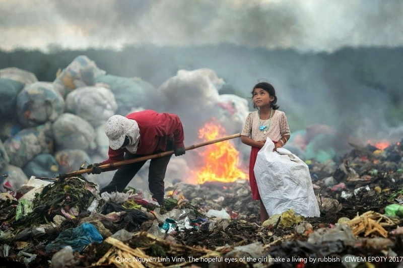 girl in rubbish award winning environment photography by quoc nguyen