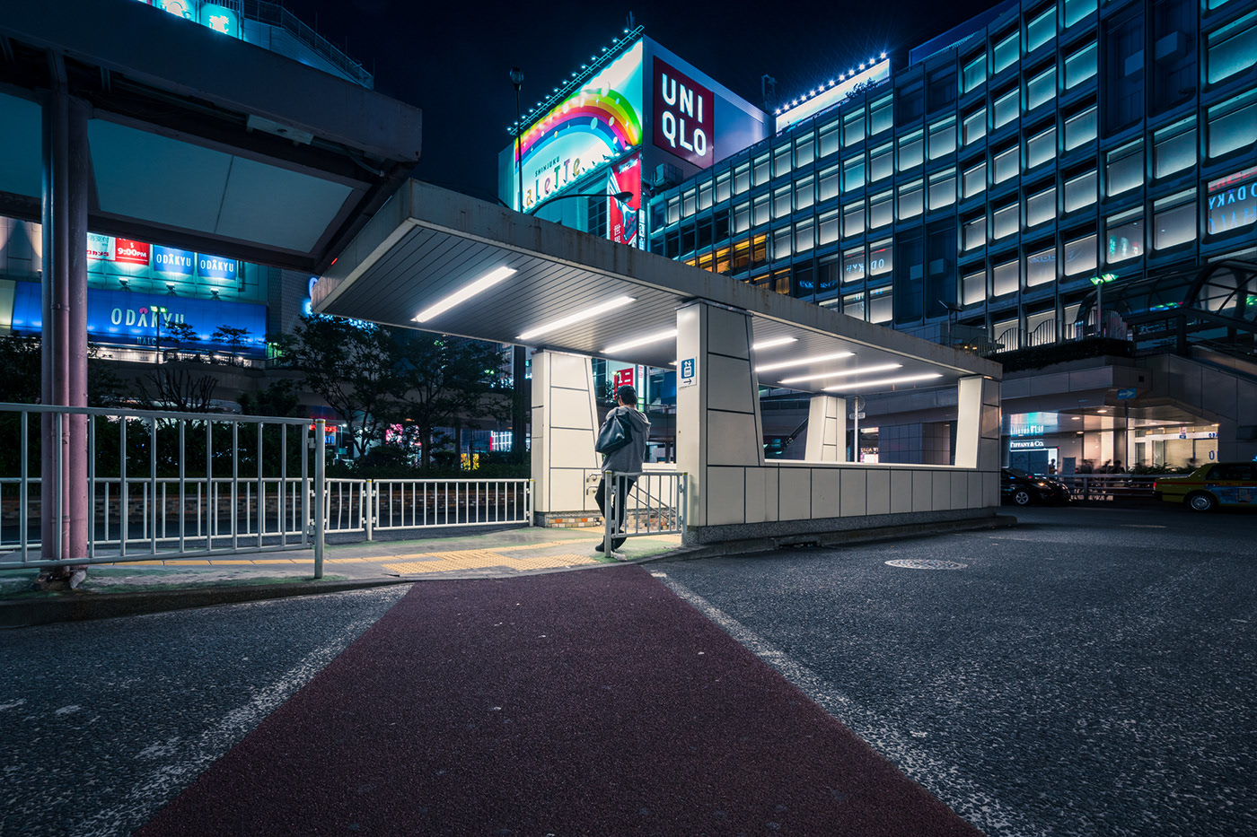 night photography city bus stop by alessandro zanoni