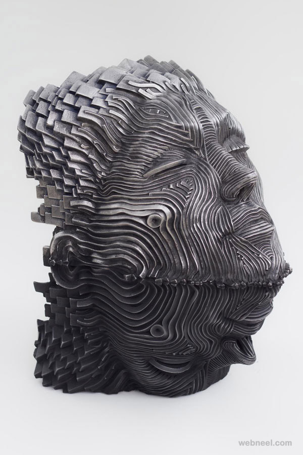 man face steel scultpure by gil bruvel