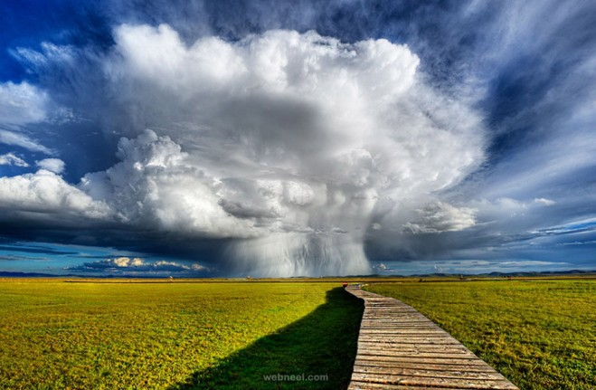 cumulonimbus clouds by hendrik tio
