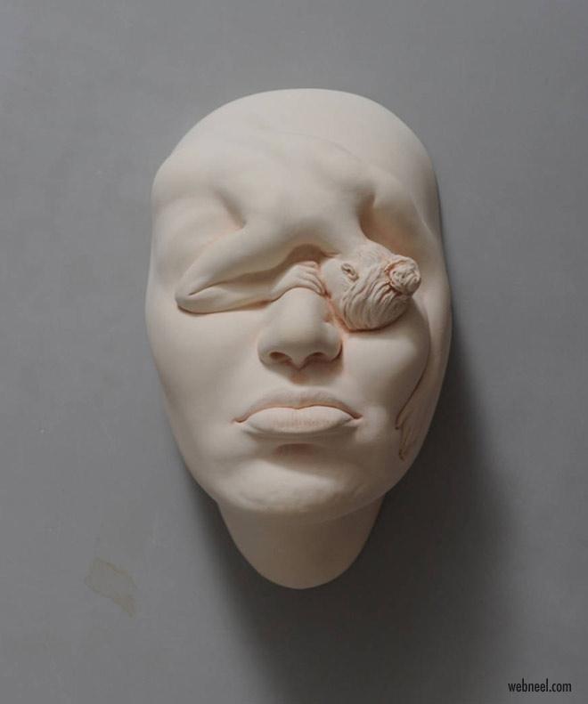 ceramic sculpture face by johnson tsang