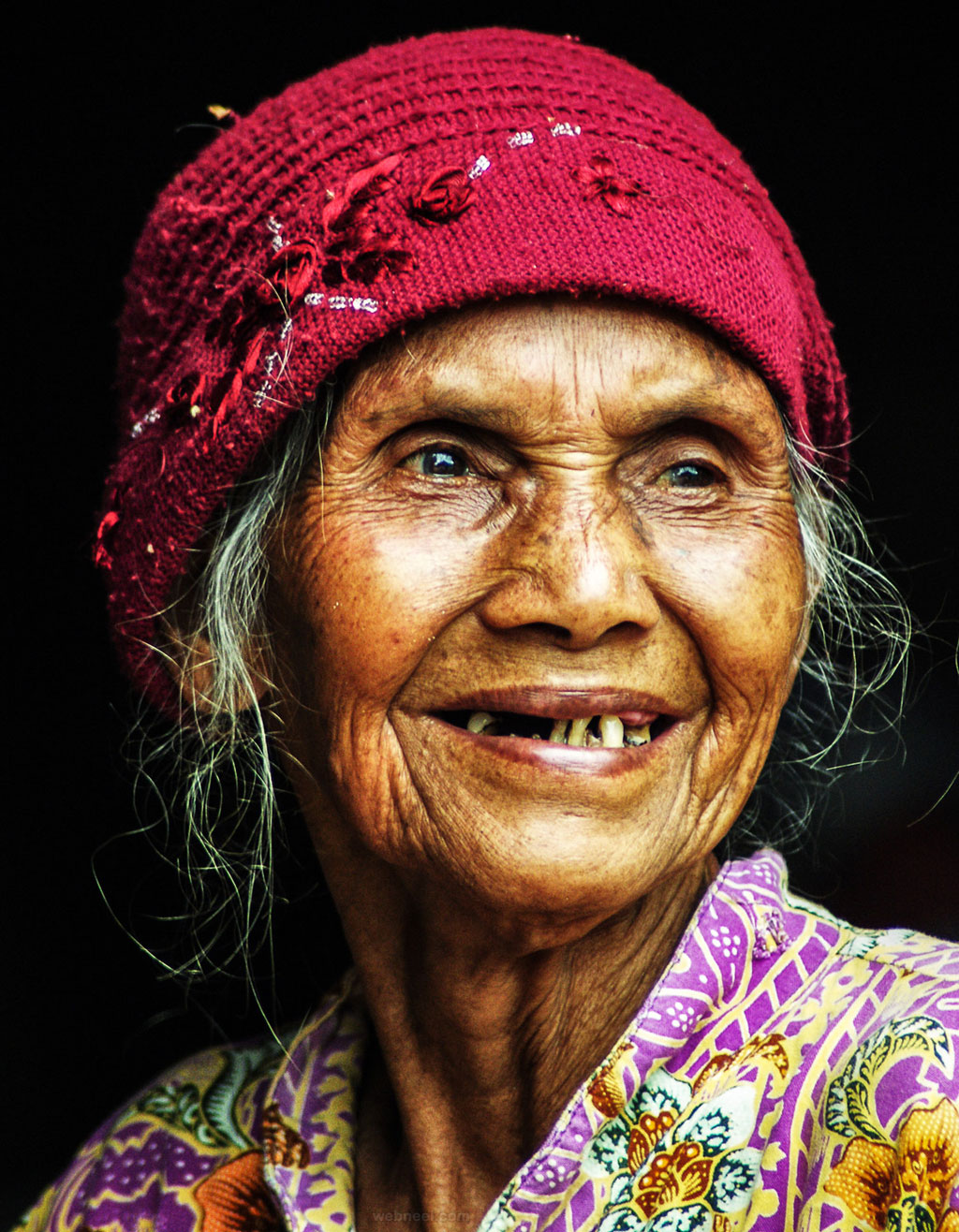 portrait photography old woman by satrio pangarso