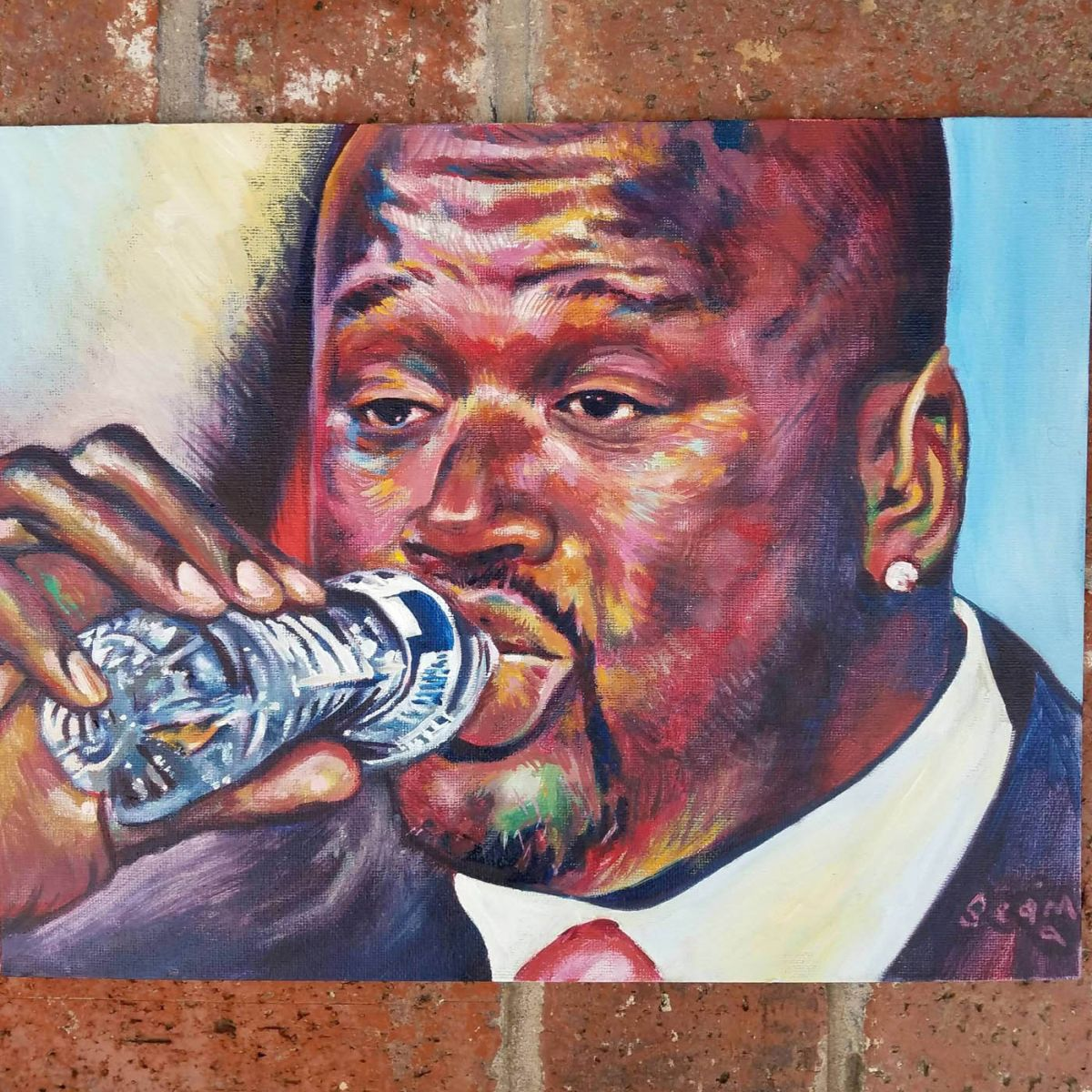 painting man drinking water