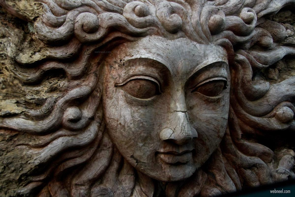 old wood carving sculpture sun god hindu
