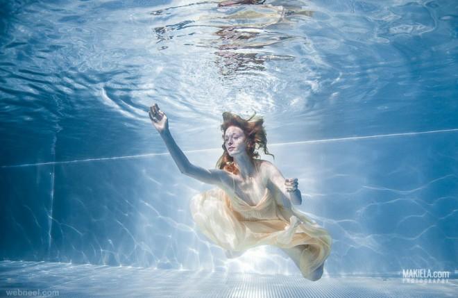 woman underwater photography by rafal makiela