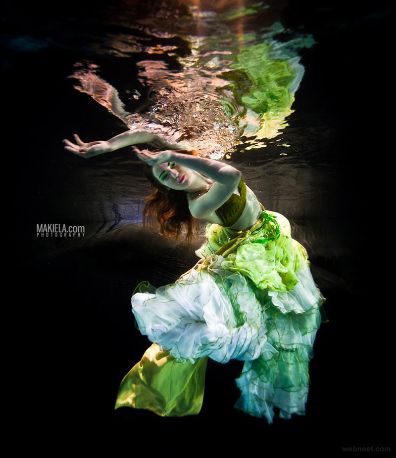 night underwater photography by rafal makiela