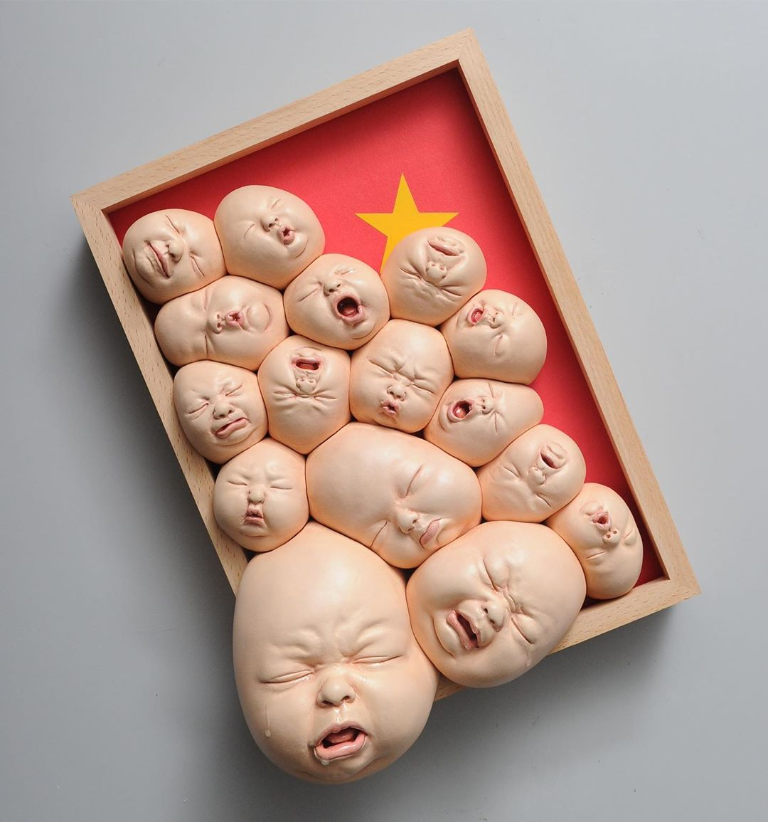 ceramic sculpture babies by johnson tsang