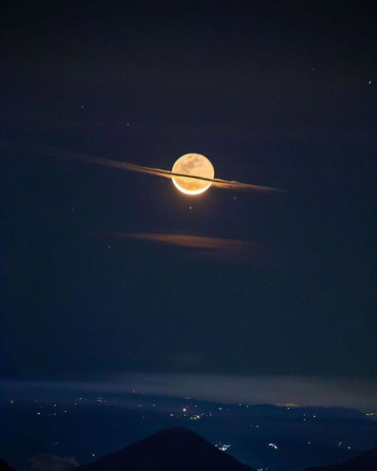 the moon dressed like saturn photography by francisco soujuel