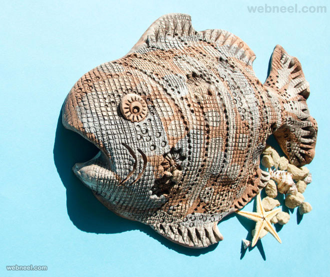 ceramic fish wall sculpture