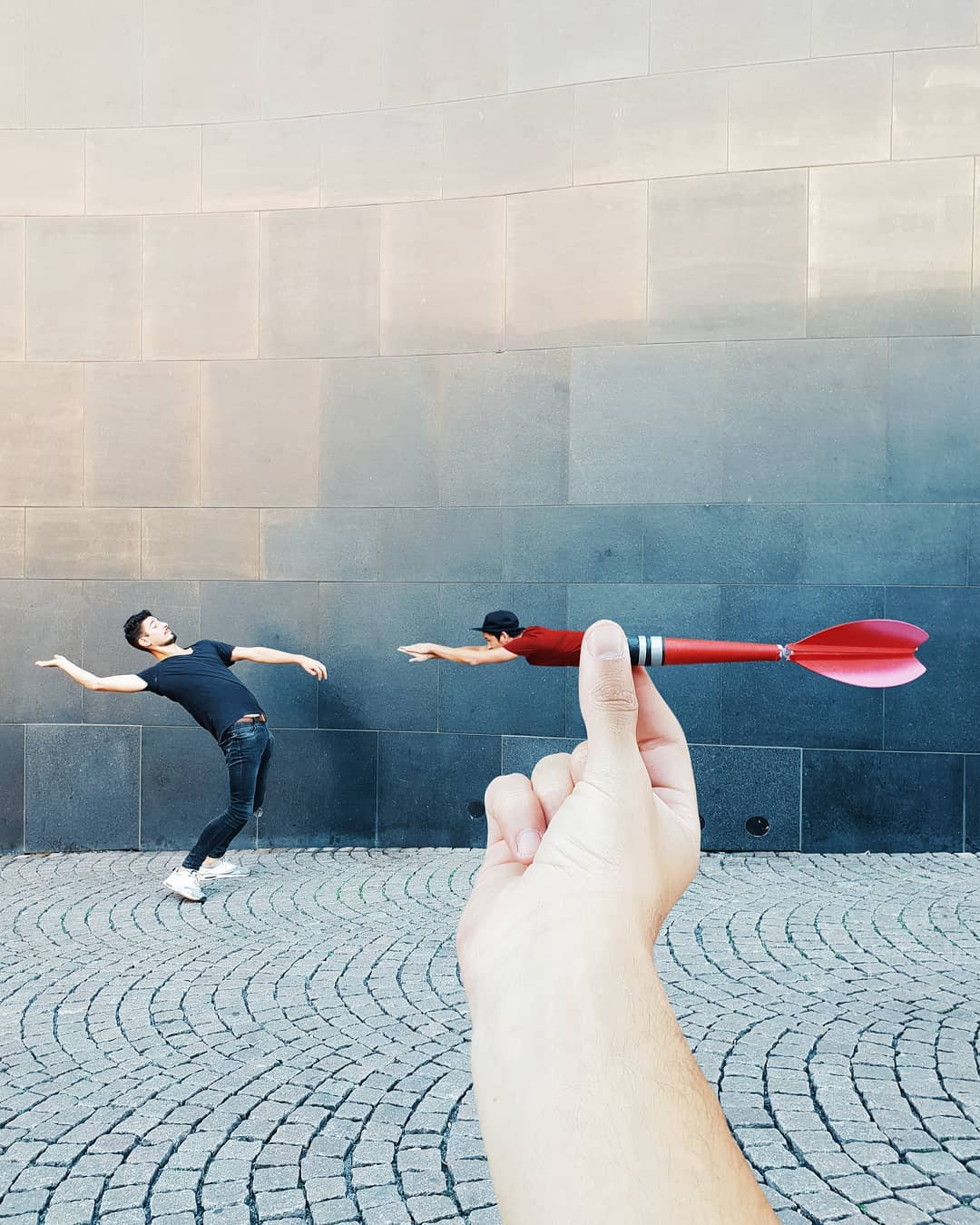 forced perspective photography dart by hugo suissas