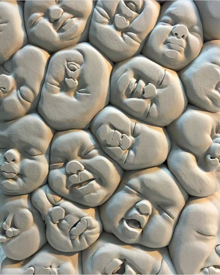 sculpture squishes heads by johnson tsang