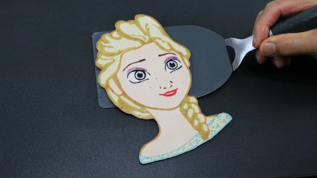 Dosa Art of Princess Elsa on a Frying Pan by Tiger Tomato